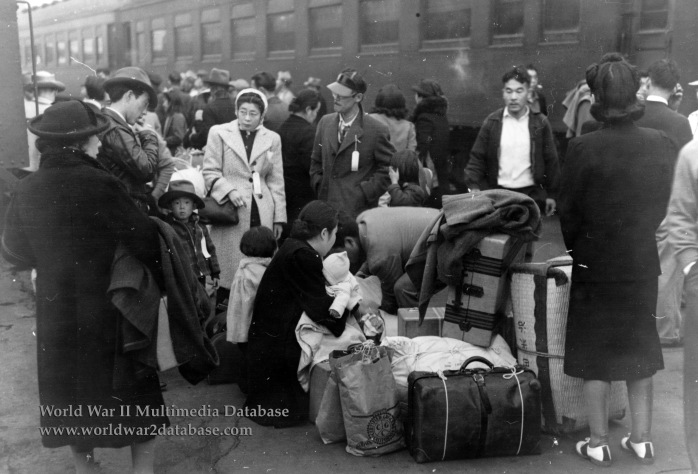 Japanese Americans Wait for Special Train to Take Them to Manzanar War Relocation Center